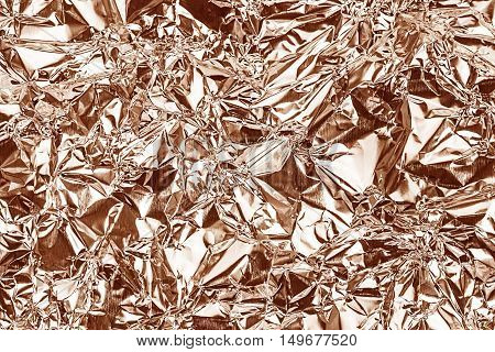 Shiny foil texture for background and shadow. Crease. Rose gold color