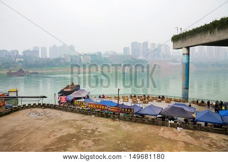 Chongqing China - December 30 2014: A view of the Yangtze river and the city of Chongqing from Ciqikou old town a famous tourist destination on December 30th 2014 in Chongqing
