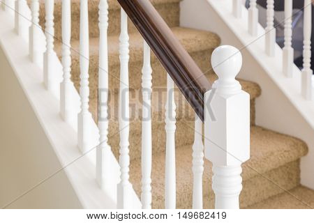 Abstract of Beautiful Stair Railing and Carpeted Steps in House.