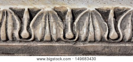Detail of an ancient temple frieze with plant motif in Roman Forum