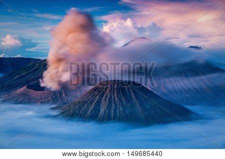Bromo Batok and Semeru volcanoes at sunrise Java island Indonesia