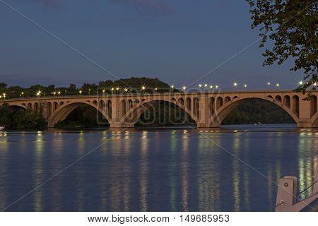 Night scene of Key Bridge in Washington DC USA. Bridge with reflections at dusk.