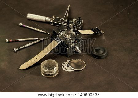 abstract watchmaker with retro style on leather background - can use to display or montage on product
