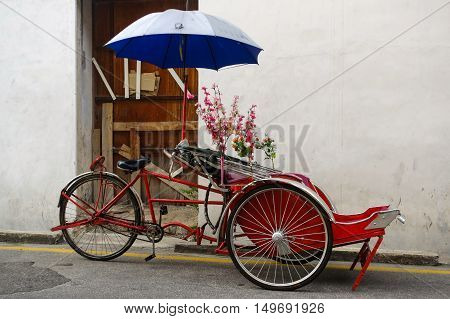Georgetown Penang Malaysia - April 18 2015: Classic local rickshaw in George Town Penang in Malaysia