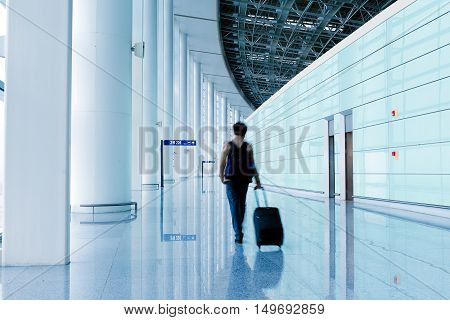 Passengers in the airport terminal building motion blur