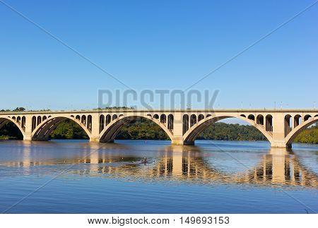 A beautiful morning on Potomac River near Key Bridge in Washington DC USA. Kayaking activity in quiet waters of Potomac River in the morning.