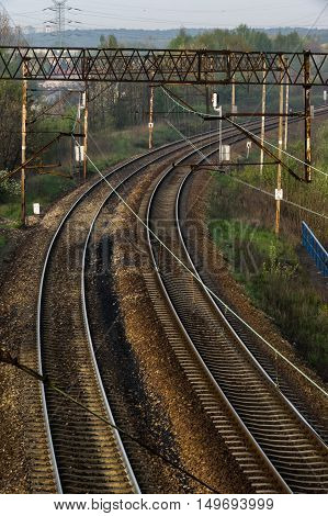 a twisting railway tracks with electric traction
