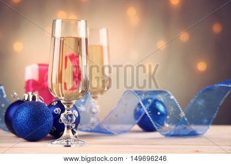 Glasses of champagne with gift box and christmas balls