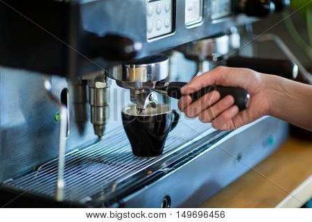 Waitress making cup of coffee in caf\x92\xA9