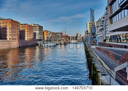 HAMBURG, GERMANY - MARCH 26, 2016: Harbor city combines old and new architecture