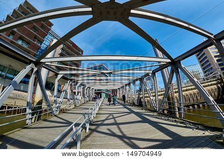 HAMBURG, GERMANY - MARCH 26, 2016: Tourists pass skywalk at new harbor city