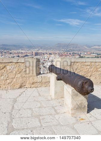 Alicante - 4 October 2015: A view of the city from the top of the ancient fortress of Santa Barbara and the cast-iron cannon October 4 2015 El Campello Costa Blanca Spain