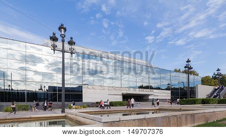 Barcelona - October 11 2015: Palace of Congresses in Barcelona is located near the Plaza de España and the people and tourists walk October 11 2015 Barcelona Spain