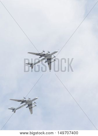 Moscow - May 9 2015 two Tu-95 refuel in the air flying in the sky over Red Square on May 9 2015 Moscow Russia