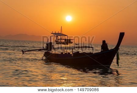 Sunset view wirh boats at pranang beach of Railay Krabi Thailand