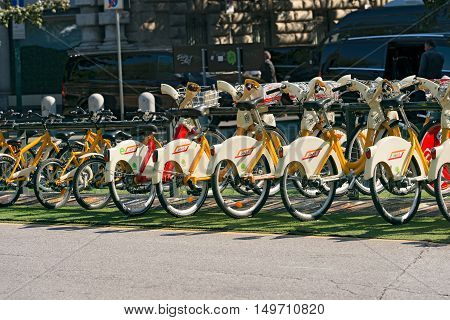 MILANO ITALY - SEPTEMBER 24 2016: City bikes for rent parked in Milan Lombardy Italy. Bike sharing service operated by the bikeMi company