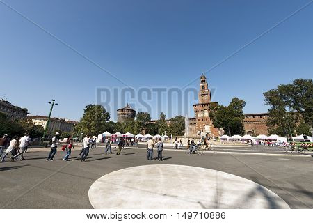 MILAN ITALY - SEPTEMBER 24 2016: People walking in the square in front of the Sforza Castle XV century (Castello Sforzesco) symbol of the city of Milan Lombardy Italy