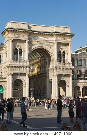 MILANO ITALY - SEPTEMBER 24 2016: Entrance from Duomo Square of the Vittorio Emanuele II Gallery famous shopping center with glass dome and ornaments in Milan Milano Italy