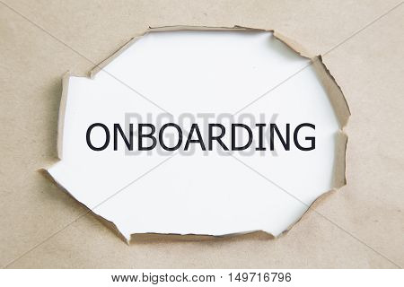 Onboarding written under torn white paper. business concept