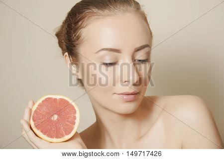 young woman with grapefruit skincare portrait closeup poster