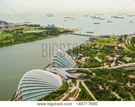 SINGAPORE, REPUBLIC OF SINGAPORE - JANUARY 09, 2014: Singapore city skyline. Aerial view of Supertree Grove and Tropical Forest Dome, Gardens by the Bay, Singapore