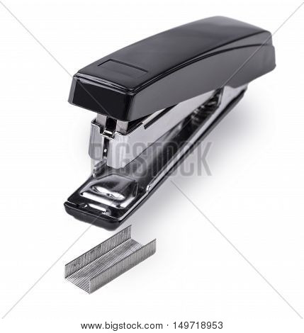Black stapler and staples to him isolated on white background