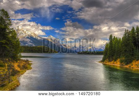 Scenic Maligne Lake and trout spawning river in the Canadian Rocky Mountains Jasper National Park Alberta