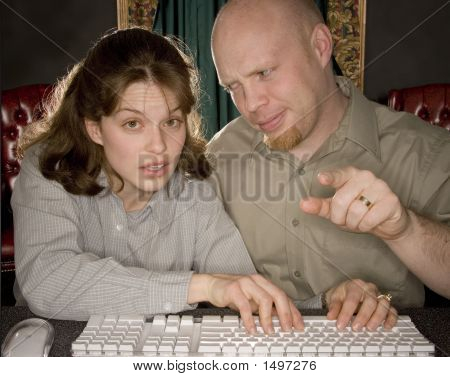 Man Teaching Woman Computer
