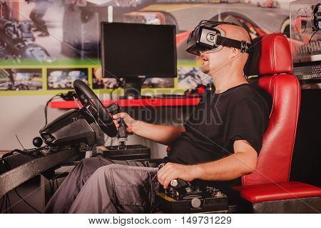 Man Playing Game In Virtual Reality Glasses