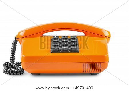 Old orange phone with shadow on a white background