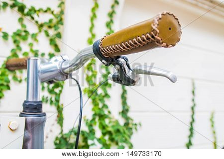 detail of a bicycle handlebar hang on the wall
