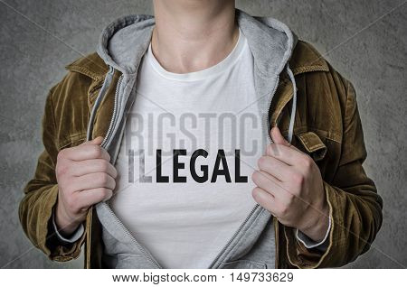 Man showing Legal tittle on t-shirt. Choosing Legal instead of Illegal.