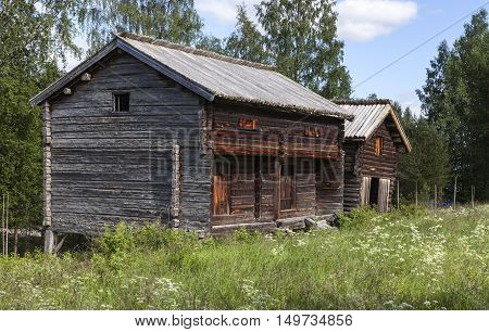 HARJEDALEN, SWEDEN ON JULY 07. View of an old homestead in the countryside on July 07, 2016 in Harjedalen, Sweden. Building in log, timber surrounded by farmland and forests. Editorial use.