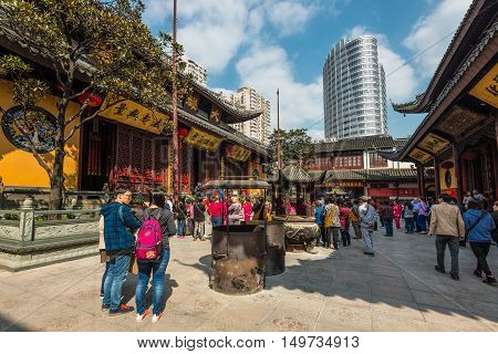 Shanghai China - October 26 2013: People visit the Jade Buddha Temple (founded 1882) in Shanghai China. Buddhism is enjoying a revival in modern liberal China.