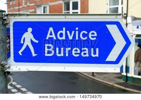Advice Bureau sign on the street of Axminster