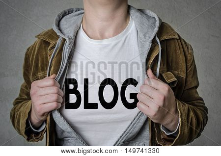 Man showing BLOG title on t-shirt. Blogging concept.