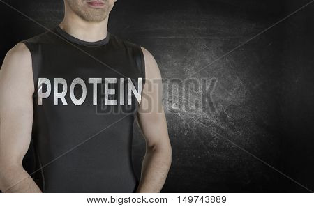 Protein. Conceptual image of healthy life. Caucasian male fit model on black background.