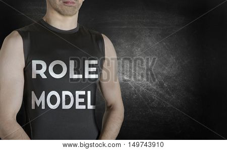 Role model. Conceptual image of healthy life. Caucasian male fit model on black background.
