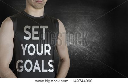 Set your goals. Conceptual image of healthy life. Caucasian male fit model on black background.