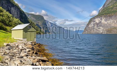 Small Hut In Undredal With The Fjord In The Background, Norway