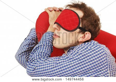man wearing a mask for sleep asleep in the chair. guy in a plaid shirt asleep on the job. isolated on white background