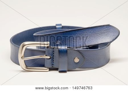 Blue leather belt and silver buckle on white background.