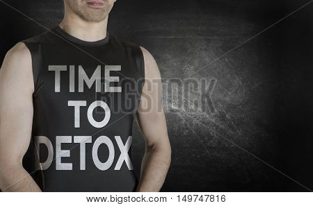Time to Detox. Conceptual image of healthy life. Caucasian male fit model on black background.