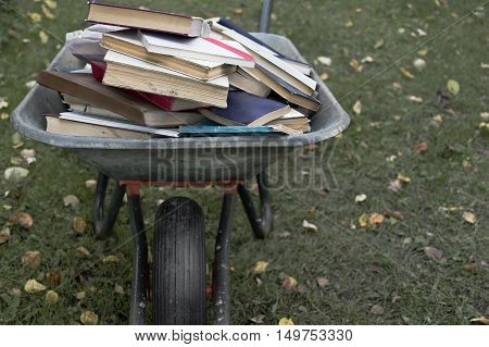A garden trolley full of old book, outdoor shot with particular focus