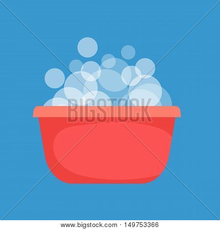 Red plastic bowl with very soapy water