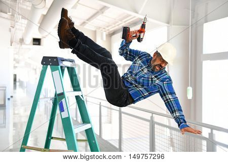 Hispanic worker falling from ladder inside building