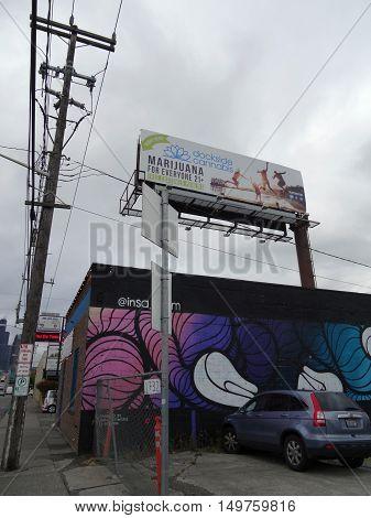SEATTLE - JUNE 24: Legal Dockside Cannabis building with mural and billboard along street taken Seattle Washington on June 24 2016.