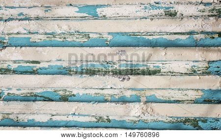 horizontal image of a blank background of tans and blues in a stripe pattern .