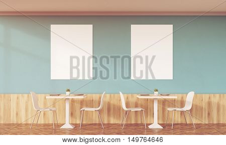 Sunlit Family Cafe With Two Posters And Green Walls