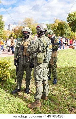 SAMARA RUSSIA - SEPTEMBER 11 2016: Unidentified members of military club in camouflage army uniform and helmet (full gear) during military reenacting in Samara Russia